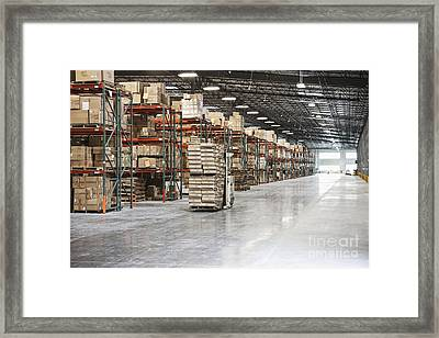 Forklift Moving Product In A Warehouse Framed Print by Jetta Productions, Inc