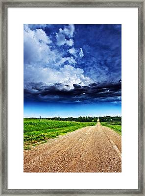 Forming Clouds Over Gravel Framed Print