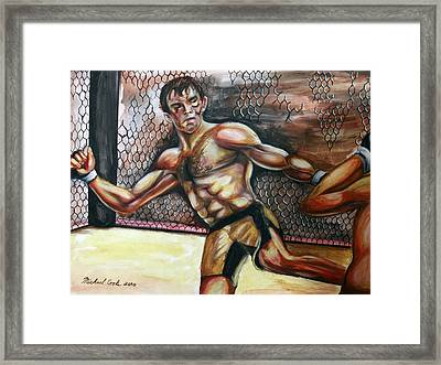 Forrest Griffin Vs. Hector Ramirez Framed Print by Michael Cook