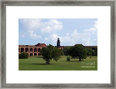 Fort Jefferson Parade Grounds And Harbor Light Framed Print by Jason O Watson
