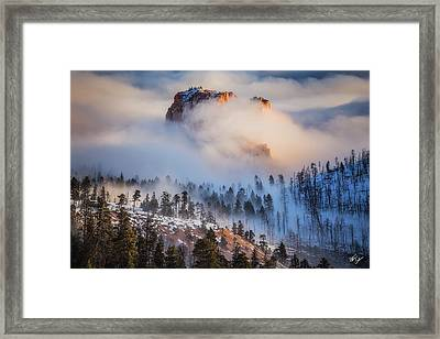 Fortress In The Clouds Framed Print by Peter Coskun