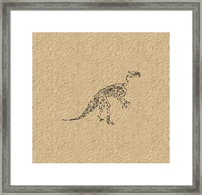 Fossils Of A Dinosaur Framed Print by Anton Kalinichev