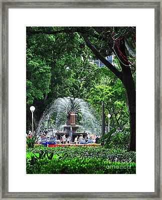 Fountain Through The Trees By Kaye Menner Framed Print by Kaye Menner