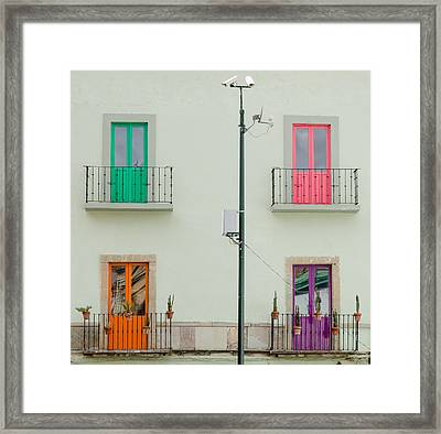 Four Coloured Doors. Framed Print by Rob Huntley