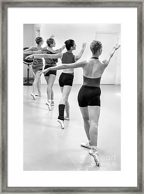 Four Female Dancers During A Ballet Rehearsal Framed Print