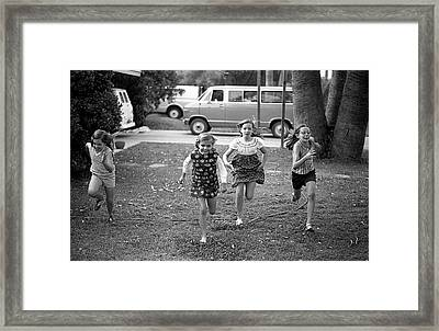 Four Girls Racing, 1972 Framed Print