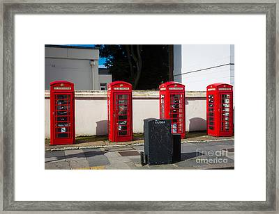 Four Phone Booths In London Framed Print by Inge Johnsson