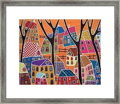 Four Trees And Houses On Orange Framed Print by Karla Gerard