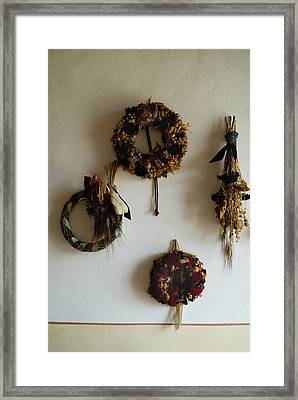 Four Wreaths Hang On The Wall Framed Print by Todd Gipstein
