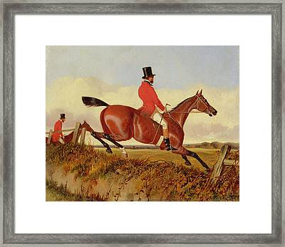 Foxhunting - Clearing A Bank Framed Print by John Dalby
