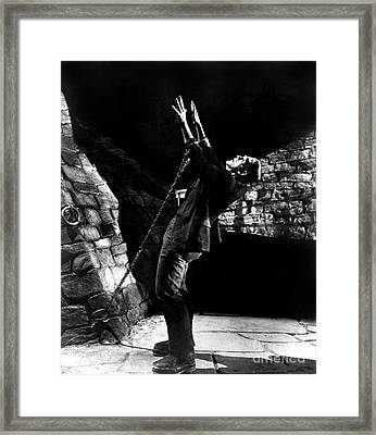 Frankensteins Monster Chained The Castle Played By Boris Karloff Framed Print