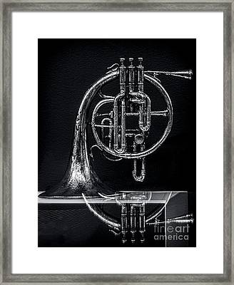 French Horn Beyond A Glass Table Framed Print by James Aiken