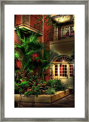French Quarter Courtyard Framed Print by Greg and Chrystal Mimbs