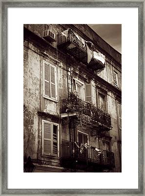 French Quarter Shutters And Balconies In Sepia Framed Print by Chrystal Mimbs