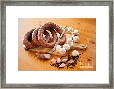 Fresh Home Made Sausage Twisted Framed Print by Arletta Cwalina