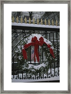 Fresh Snow Covers A Christmas Wreath Framed Print by Stephen St. John