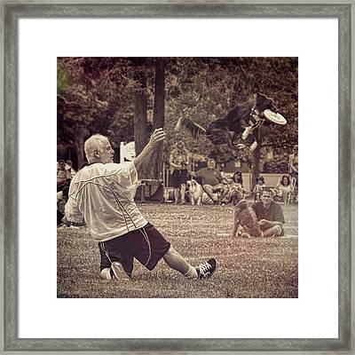 Framed Print featuring the photograph Frisbee Catcher by Lewis Mann