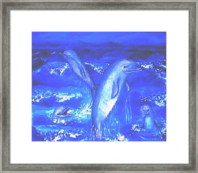 Frolicking Dolphins Framed Print by Tanna Lee M Wells