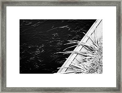 Frost On Edge Of Frozen Small Lake Pond On A Cold Winter Morning In The Uk Framed Print by Joe Fox