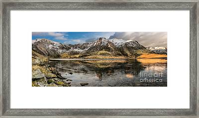 Frozen Lake Idwal Framed Print by Adrian Evans