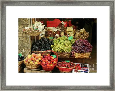 Fruit Vendor Sienna Framed Print by Georgia Sheron
