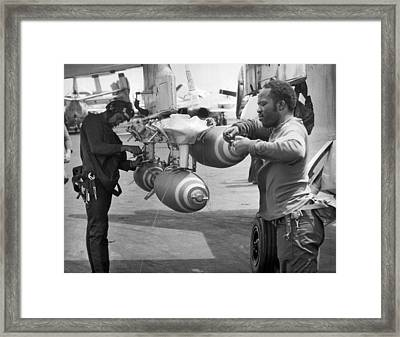 Fusing Bombs For North Vietnam Framed Print by Underwood Archives