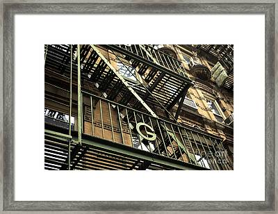 G In The Village Framed Print by John Rizzuto