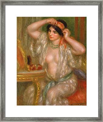 Gabrielle At The Mirror Framed Print by Pierre Auguste Renoir