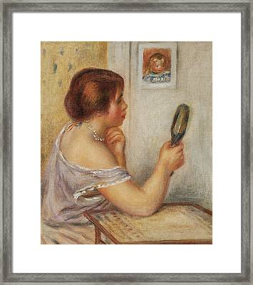 Gabrielle Holding A Mirror Or Marie Dupuis Holding A Mirror With A Portrait Of Coco Framed Print by Pierre Auguste Renoir