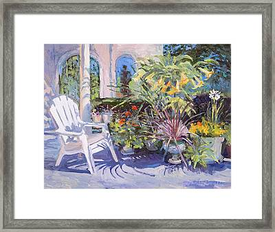 Garden Chair In The Patio Framed Print