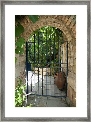 Framed Print featuring the photograph Garden Door Entrance by Yoel Koskas