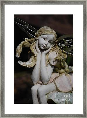 Framed Print featuring the photograph Garden Fairy by Lila Fisher-Wenzel