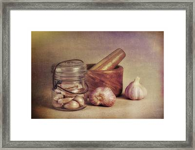 Garlic In A Jar Framed Print by Tom Mc Nemar