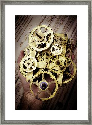 Gears Held By Hand Framed Print