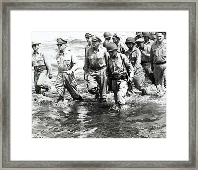 General Douglas Macarthur Wades Ashore At Leyte On His Return To The Philippines Framed Print by American School