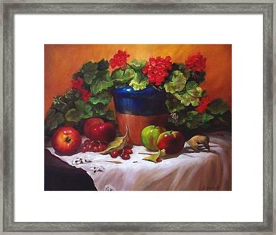Geraniums And Apples Framed Print by Donna Munsch