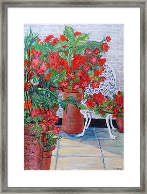 Geraniums And Petunias On The Terrace Framed Print by Joan Thewsey