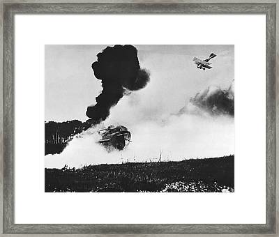 German Biplane Attacks Tank Framed Print by Underwood Archives