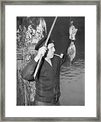 German Crewman Fishes In Sf Framed Print by Underwood Archives