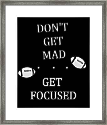 Get Focused Football Framed Print by Dan Sproul