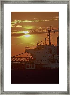 Getting Underway At Sunset Framed Print by John Glass