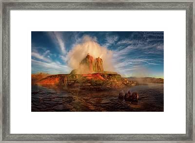 Geyser Steams At Dawn Framed Print