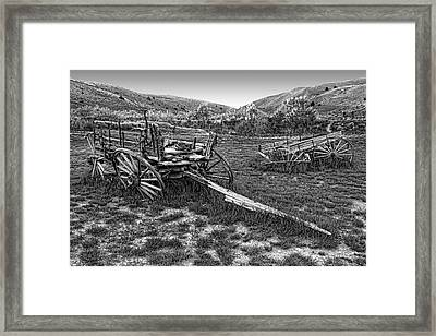 Ghost Wagons Of Bannack Montana Framed Print by Daniel Hagerman