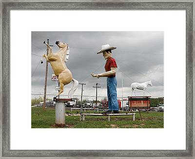 Giant Cowboy And Horses Framed Print by Tony Grider