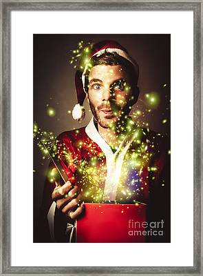 Gift Wrapping Santa With Magical Christmas Present Framed Print by Jorgo Photography - Wall Art Gallery