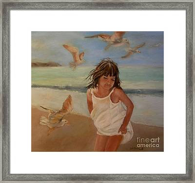 Girl And The Seagulls Framed Print