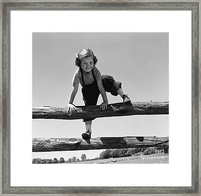 Girl Climbing Over Wooden Fence Framed Print by H. Armstrong Roberts/ClassicStock