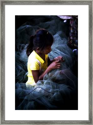 Girl Fixing Nets Framed Print