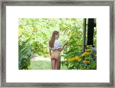Girl In Swedish Garden Framed Print