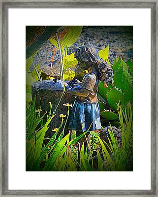 Framed Print featuring the photograph Girl In The Garden by Lori Seaman